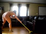 Chubby Woman Cleaning the House